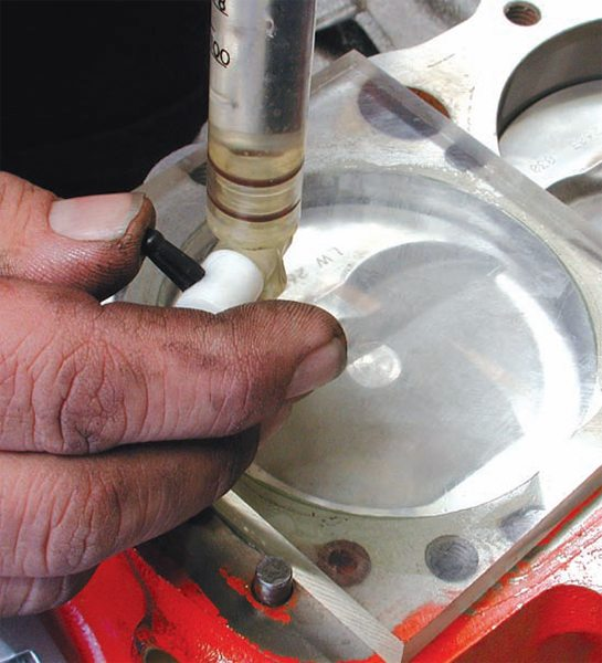 To cc a cylinder, coat the cylinder wall with light grease or oil to help seal the right gap. Rotate the engine until the piston top is far enough down the bore to clear the dome. Measure the depth with a dial indictor and compute the empty volume using the cylinder volume formula. Then cc the cylinder to find out how much volume the dome displaces. Subtract that value from your compression volume.