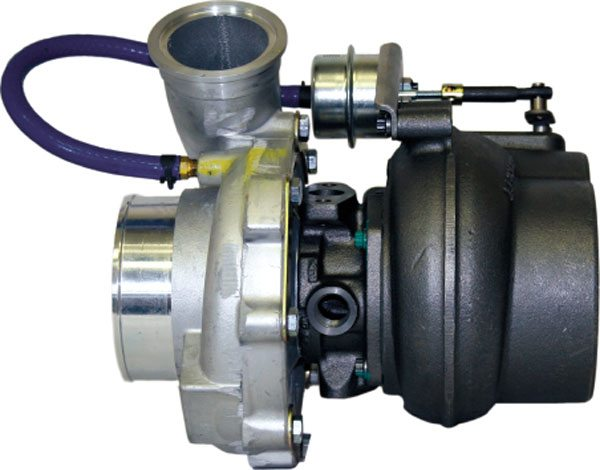 The Garrett Model GTP38 as shown was used on the 7.3-liter Ford Powerstroke diesel engine in heavy-duty pickups. This turbocharger used a pedestal mount and employed a wastegate assembly that allowed improved low-end response. (Courtesy Diesel Injection Service Company, Inc.)