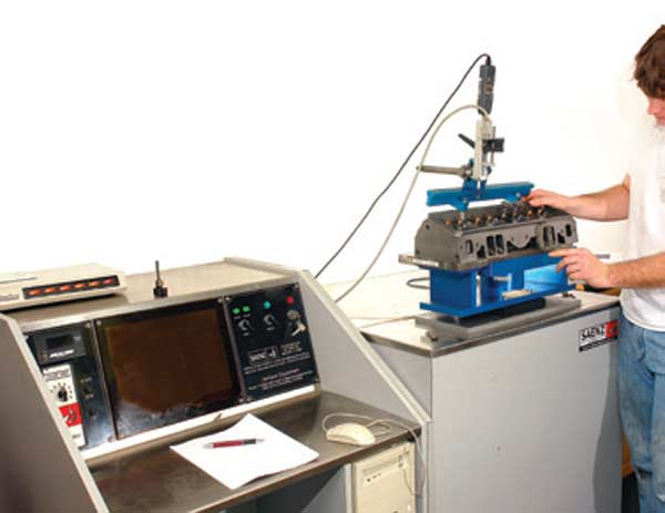 Fig. 3.23. The Saenz J-600 bench I currently use. It comes fully instrumented with the Audie Technology electronics and computer software. Also available is the automatic valve opener seen here, which speeds up testing significantly.