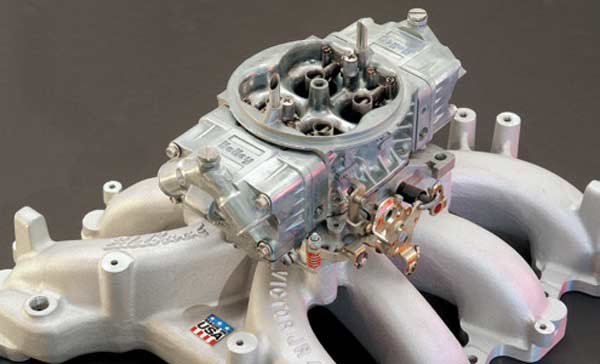 Fig. 5.24. The Edelbrock carb and intake used to replace the 4.6's fuel injection induction system was worth more than 50 hp. This was the setup used to test the TFS heads for a race application. 25