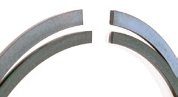 Fig. 11.27. The trend over the years has been for piston rings to become thinner and have less radial depth. Also, duty cycle permitting, the ring pack as a whole has moved toward the piston crown.
