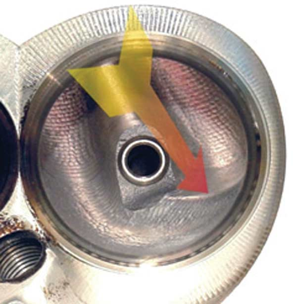 Fig. 4.5. This shot shows the effort that GM put into the development of the 427 Corvette engine's cylinder heads. The arrow indicates the fuel ramp, incorporated with apparently little flow loss.