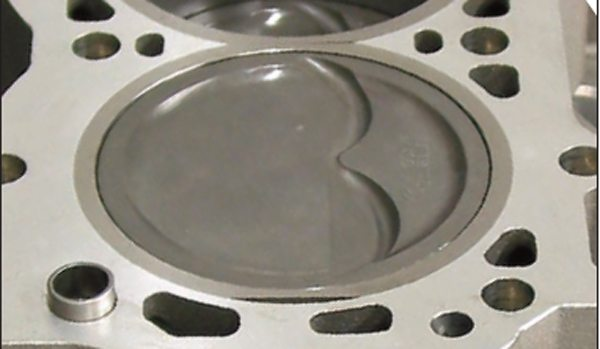 Dished pistons are designed to reduce compression ratio by increasing the compression volume above the piston. Many of them don't have valve reliefs because the dish is already deep enough. You can use the published dish volume for your compression ratio calculations or cc a piston top to verify it.