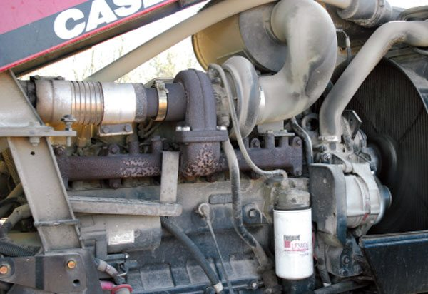 This 1999 Case-IH MX150 uses a fixedgeometry, or free-float type turbine housing, which means no wastegate or other type of variable turbine geometry. This type of turbo system is the most commonly found type in use today. The engine is rated at 130 hp, with 5.9 liters of displacement and a Holset brand H1 model turbocharger. Most agricultural tractors, from brands such as John Deere, Case-IH, Massey Ferguson, etc., rated over 100 hp use a turbocharger. All of today's on-highway diesels use a turbocharger because they have to in order to meet emissions regulations.