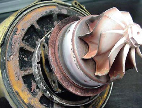 This turbine failure was caused by excessive heat where turbine material fragments were literally thrown off at extremely high rotational speed under extreme temperatures. Note the discoloration and look of the burned blade tips. (Courtesy Honeywell Turbo Technologies)