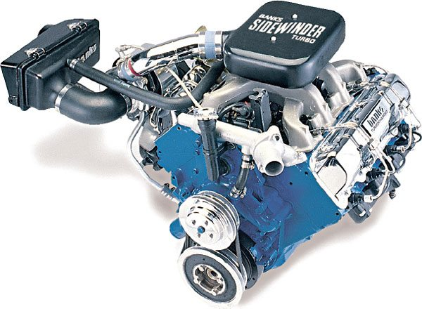 """This is the turbo diesel retrofit kit for the older GM 6.2-liter diesel engine. Gale Banks Engineering sold these by the thousands for GM pickup trucks and Suburbans. This kit played a major role in the development of the """"consumer diesel"""" performance boom as the sport truck trend revved-up in the early '90s. The turbocharger used in this kit was a T04B25 model that used Banks' own end housings. Note the fact that this turbo system was not aftercooled. The compressor discharge boost tube runs directly to the intake plenum. The mild boost created by this system, 7 to 9 lbs., allowed the fuel setting on the injection pump to be legally stepped-up to match with the higher airflow. Once completed, the turbocharged 6.2-liter engine, which was normally a slug in the performance category, drove like it was a big-block 454 gas engine, but got diesel fuel economy! (Courtesy Gale Banks Engineering)"""