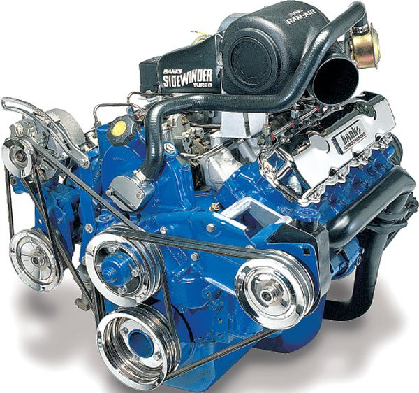 """Gale Banks Engineering also manufactured a turbo retrofit kit for the 6.9/7.3-liter indirect-injected diesel made by International Truck and Engine for Ford trucks. The turbocharger used in this kit is the same T04B25 model turbocharger as used in the GM 6.2-liter kit. While this illustration does not show the actual turbocharger, Banks positioned the turbo on his redesign of the 7.3-liter kit in a superior manner than in his previous kit design where the turbocharger was positioned at an angle rear of the intake manifold. This facilitated improved intake and exhaust plumbing to enhance overall turbo system design. The twisted angle Banks used on the 7.3 turbo kit redesign was the origin of the """"sidewinder"""" name as it now applies to Banks' turbocharged light truck engines. This kit is not aftercooled due to the mild boost. Once turbocharged, both the 7.3 Ford and the 6.2 GM diesels produced about 50 percent more horsepower. The slightly higher power and displacement of the 7.3 diesels, once turbocharged, created the most powerful light-duty truck engine package of the mid 1980s, gasoline or diesel. (Courtesy Gale Banks Engineering)"""