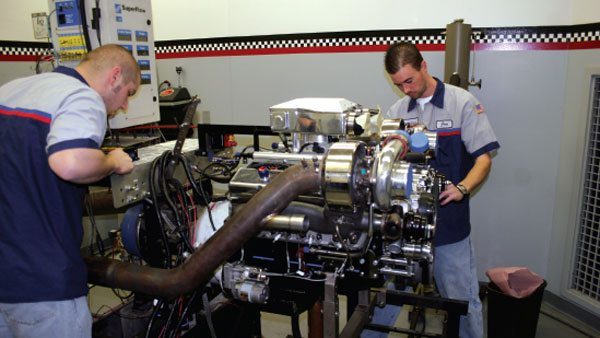 Banks dyno room technicians prepare to test recent modifications to the Banks twin-turbo setup. While Banks has marketed this kit for over 25 years, they continuously refine it and update it to include all of the latest turbo design features, electronic tuning elements, and engine modifications developed through their on-going racing programs. Banks knows if you're not driving the technology, the technology will drive you to play catch-up.