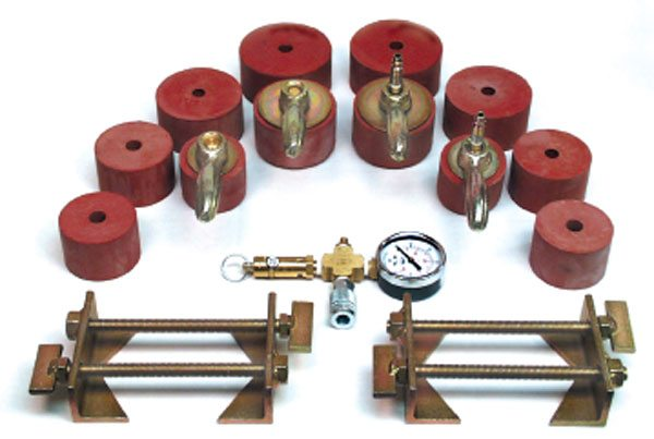 The Quick Check leak test kit from Av-Tekk, a commercial diesel charge-air cooler supplier, is a universal aftercooler test kit that fits most every size cooler inlet and discharge diameters. Note the pressure relief valve/pressure gauge combination and the positive restraints that clamp around the hose bead of the cooler for operator safety during testing. (Courtesy Av-Tekk)