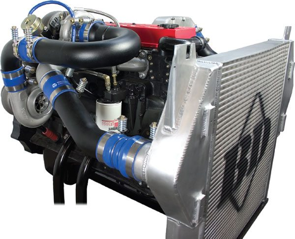 BD power of Abbottsford, British Columbia, Canada, is a maker of several performance diesel products, including this compound turbo setup called the Twin B. Applied to the Cummins B-series 5.9-liter engine, it will support up to about 675 hp with the proper fuel system modifications. The upper stage is an S200-S300 model combination BorgWarner turbocharger, with a 60-lbs/min flow capacity, while the lower stage is also a BorgWarner S300 that flows about 80-lbs/min. (Courtesy BD Power)