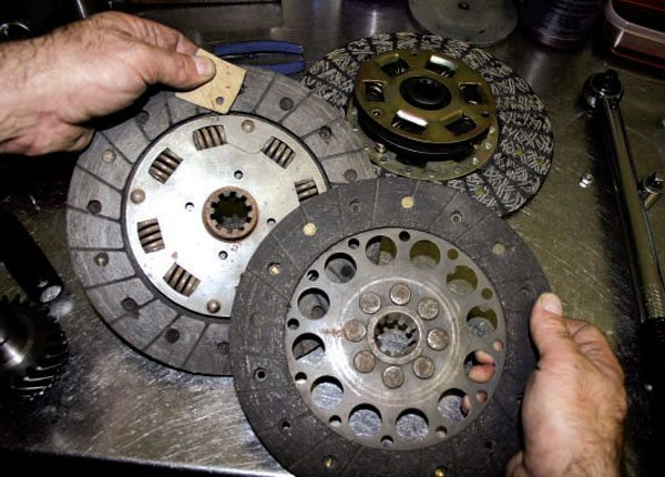 Here are some Ferrari racing clutches. The one on the right is a solid clutch with no marcel and no springs. The hub is riveted solid to the lining.