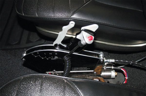 The Precision Performance Products shifter installed very neatly between the seats of a 1970 Cutlass W-31.