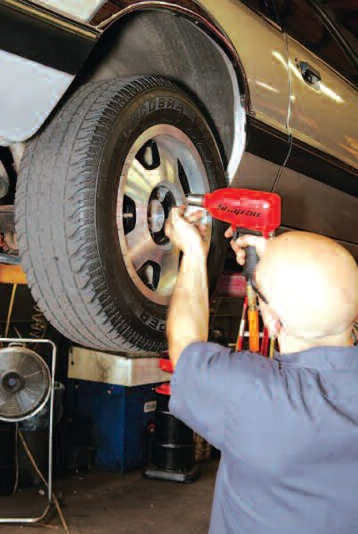Before working on the axle itself, first remove the wheels. Use an impact gun to remove the lug nuts. (Randall Shafer)