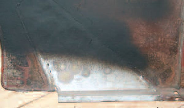 Someone had begun to repair this front fender before it came to me. The cause of the rust-out was a Y-configured rubber seal against its inside, in the area where the repair was made, and where the factory didn't apply paint. Adequate coating and undercoating should cure that problem.