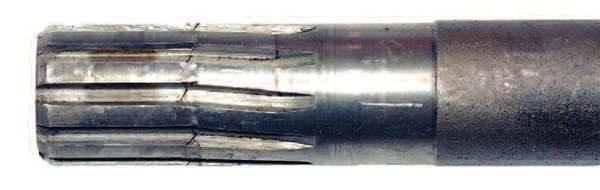 Occasionally, you get lucky and catch a problem right before the failure happens. This splined end of an axle shaft has started to permanently deform. It was just a matter of time before this shaft twisted off. Note the lack of a C-washer groove in the shaft. This banjo-style axle from an Austin Healey has a straight-cut tooth profile and the coarse (or low) number of teeth. This is a great example of how not to design a splined connection. This is also a great example of the importance of thoroughly inspecting the components when you disassemble the axle.