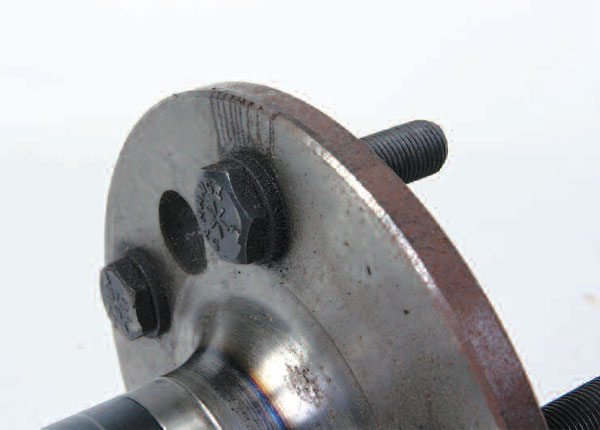 A screw-in-style stud on a typical aftermarket shaft looks like this. A good sign of a quality stud is that the studs actually have the manufacturer's name on them. These are from Strange Engineering.