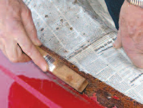 Hand or power wire brushing near the visible rust released loose paint, revealing additional weak areas lurking under the finish. This is essential knowledge to have before you begin repairs.