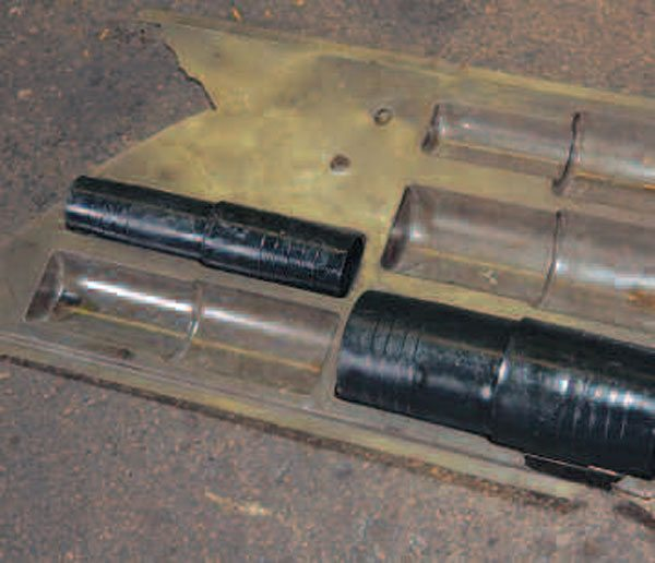 This tool is a plastic plug of the proper size and can be helpful to keep the transmission from leaking fluid once the driveshaft has been removed. (You can purchase an assortment of these to cover most common applications.) An old driveshaft can work or even a small plastic bag that is held in place with a rubber band can work in the short term. (Randall Shafer)