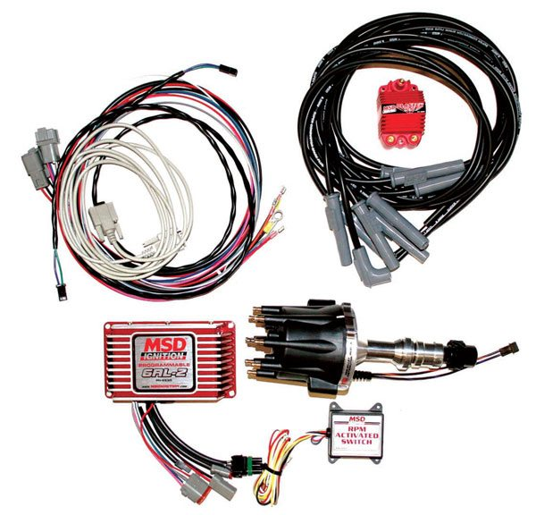 MSD sells complete high-performance ignition systems designed to deal with the high RPM, heat, and abuse typical of racing. This particular kit includes everything from the distributor, coil, and spark plug wires to the programmable 6AL-2 box and additional RPM-activated switches. MSD offers complete kits like this for a wide range of engine families.
