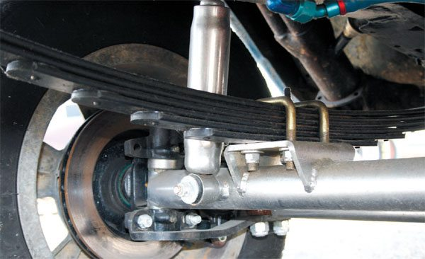 A peek underneath a tube-axle-equipped hot rod shows the simplicity of the design. In this case, the leaf springs have been mounted 90 degrees from the direction of the axle. This is much stronger but still offers little comfort on rough roads.
