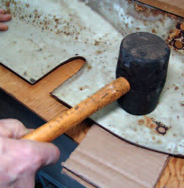 This combination, a soft rubber mallet and a corrugated cardboard backing, is about as mild as it gets. You won't knock down any ridges this way, but you may correct a small defect without creating a bigger one.