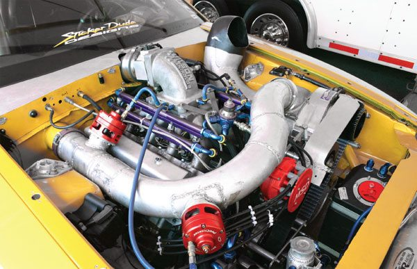 This supercharged engine makes over 1,700 hp and an appropriately large amount of boost. To vent this tremendous pressure when the throttle is closed, two bypass valves are employed to reduce the load on the compressor wheel. (Nate Tovey)