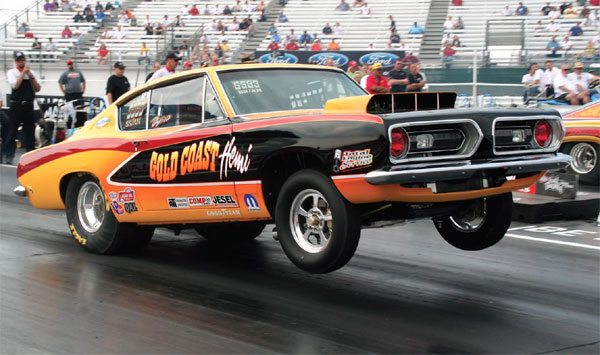This is Dan Zrust in a 1968 Plymouth Barracuda. The car competes in the notoriously tough Super Stock ranks and is powered by the venerable 426-ci Chrysler Hemi engine. This shot was taken at the 2009 NHRA U.S. Nationals in Indianapolis, Indiana.