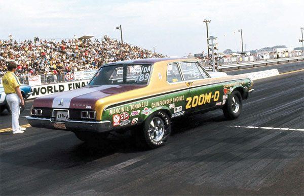 9) Here is a classic shot of legendary Mopar racer Ray Mancini from 1969. He's shown piloting a 1964 Dodge, powered by a 426 Hemi engine at the NHRA World Finals in Dallas, Texas.