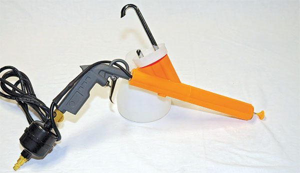 A Harbor Freight gun (shown) differs from Eastwood guns. This gun requires the powder cup to go on upside down on top of the gun, rather than screwing in from underneath.