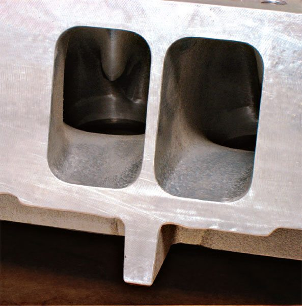 CNC-ported small-block head shows the perpendicular porting troughs that encourage efficient boundary-layer flow. Note the aerodynamically tapered valveguides shaped to mini-mize flow restriction.