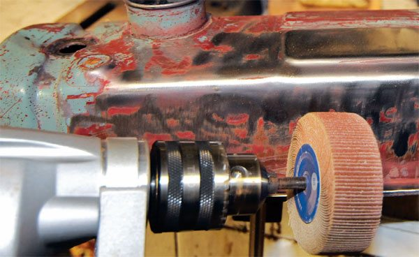 If chemical cleaners don't get the grunge off your parts, you have to scrape it off using whatever tool works. Sanding wheels, wire brushes, and scrapers are all part of your arsenal.