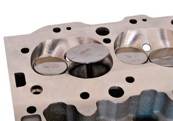 This open intake valve shows the generous valve curtain, or flow win¬dow. Canted valve angles open the valves away from the cylinder walls to provide good flow with minimal valve shrouding.