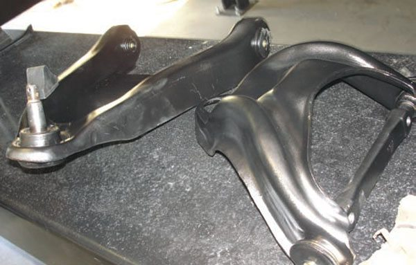 Most stock muscle cars use rubber bushings. They're cheap and hold up pretty well.