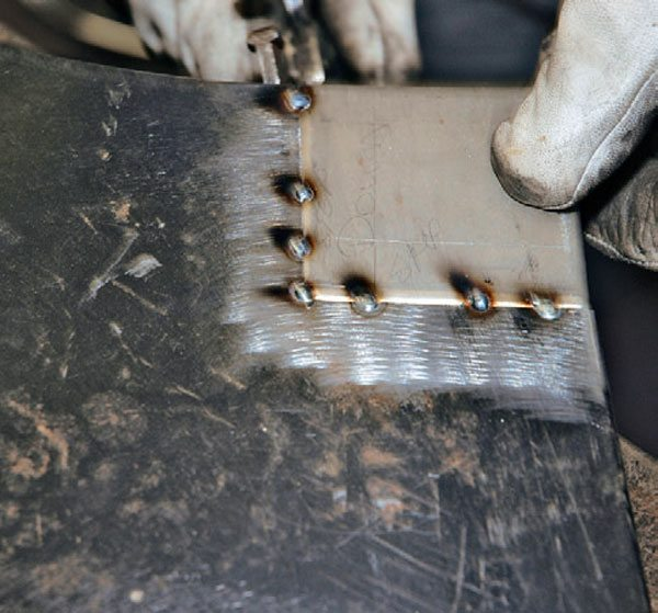 Here's an example of a sheet-metal repair that could be covered with powder coat when finished. For this project, I started by tack-welding this patch in place of damaged metal.