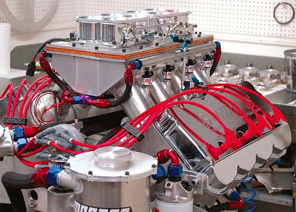 Sonny's Racing Engines builds massive 932-ci fuel-injected Pro Stock drag racing engines delivering 2,050 hp at 8,100 rpm and that's no accident. They are equipped with highly refined induction systems that pinpoint the exact air¬flow requirements of the engine's operating range while providing nearly 1,450 ft-lbs of torque at 6,700 rpm.