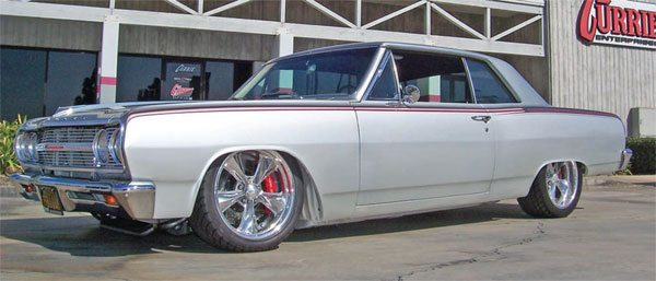 Charlie Currie's 1965 Chevelle combines classic lines with a high-tech, 770-hp, blown LS-series stroker motor, with a SC&C StreetComp-AFX front suspension, Currectrac trailing arms, Shockwaves, 14-inch-diameter 6-piston Baer brakes, and more. The result is a roomy, comfortable cruiser that handles like a slot car and has more horsepower than a Ferrari Enzo. (Photo Courtesy Currie Enterprises)