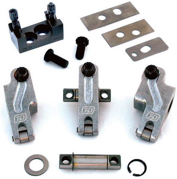 T&D Machine's rockershaft sys¬tem for Dart Big Chief heads has three different rocker arms; left offset, right offset, and straight. Each one uses its own unique rocker stand and shaft and they all use assorted shim sizes to set the proper height.