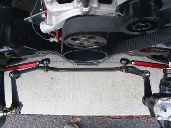 Steering ratio is not just a function of the internal gearing of the steering box but also the linkage. A longer Pitman arm makes the steering quicker. Longer steering arms make it slower. The fore/aft location of the steering pickup points also affects Ackerman.(Photo Courtesy Steve Johnston)