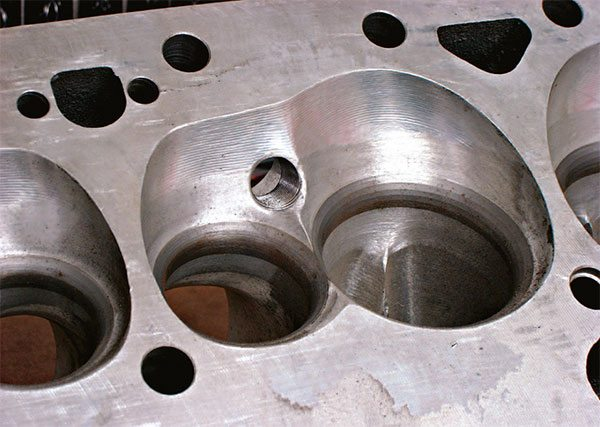 Here's a typical CNC-prepped small-block combustion chamber with bowl blending. You can just see part of the contoured intake valveguide in this picture.