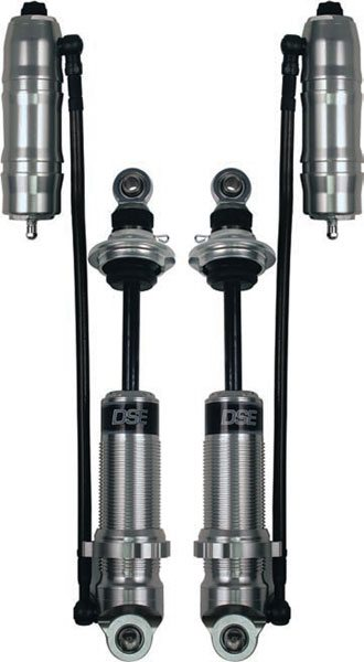 Getting even more exotic, shocks can make use of remote reservoirs for more oil volume. By the time they get this sophisticated, the manufacturer is going to make the transition to a coil-over configuration, and these double-adjustable units from Detroit Speed are no exception. Note the adjustment knob format with the rebound adjustment on the reservoir and the compression adjustment near the end of the shock shaft. This same configuration is also used by Penske and Afco. It allows the more frequently used rebound adjustment knob to be remotely mounted for easy access. (Photo Courtesy Detroit Speed and Engineering)