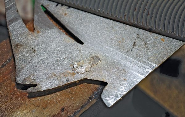 This filing job isn't perfect, and more work remains to be done, but the solder is becoming flattened. When it's perfect, no one will even know the repair was made.