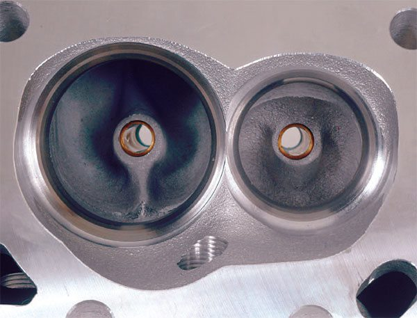 This is an as-cast Dart Pro 1 small-block combustion chamber with streamlined intake valveguide boss.