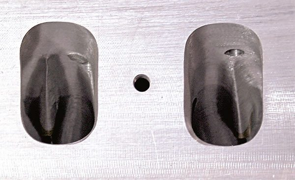 This Little Chief spread-port head shows similar porting and guide blending. The port to the right has a drilled and tapped hole in the roof for the rocker arm stud. Each port must be checked to ensure that threaded bolts or studs do not protrude into the port.