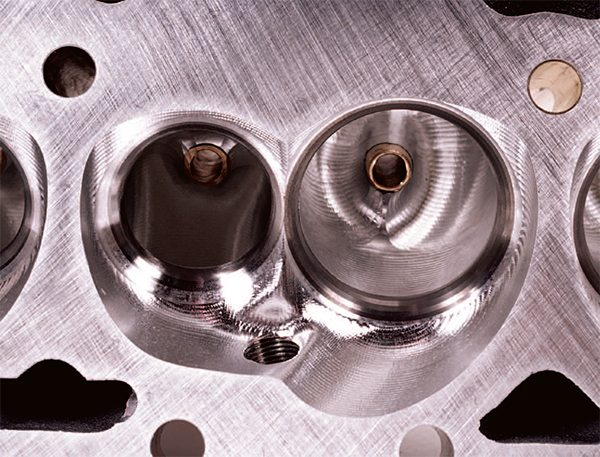 Here's the same Pro 1 chamber after full CNC porting. Note the precise valveguide blending and multi-angle valve job.