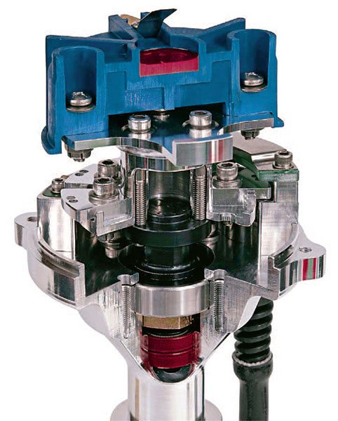 This MSD race distributor accom¬modates individual cylinder timing adjustment by mechanical means. Note that each individual trigger can be adjusted by loosening the appro¬priate screw.