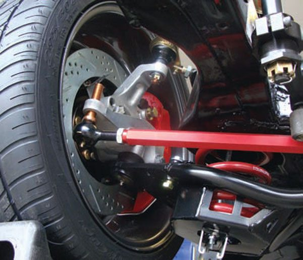 A very slick way of adjusting bump steer is Howe Racing's QuickBump tie rod ends. These modular, greaseable tie rod ends use a 5/8-inch threaded stud that's broached on the top for use with a hex wrench. You simply drill out the steering arm and tap it for 5/8-inch fine threads, and screw the studs in. And then, to make your bump adjustments, simply screw it up or down with a hex wrench. No disassembly required. Find your setting and then lock it down with the jam nut (not visible in this picture). This system gives you a high-clearance, greaseable and rebuildable, all-weather, bump steer adjustment system that easily outlasts the very best Heim joints. The ability to make very fine adjustments is also nice. At 60 mph, tiny variations in bump steer are likely unnoticed. At the 200+ mph speeds Steve Johnston's Camaro is capable of, they may be very obvious! (Photo Courtesy Steve Johnston)