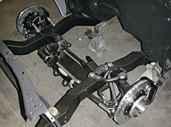 The subframes are usually mounted to the unibody structure with rubber bushings. Note the one mounting the radiator support. These bushings are supposed to isolate NVH. They don't do a very good job because they typically deflect under loading, allowing the whole subframe to move in relation to the rest of the car. (Photo Courtesy Chris Alston's Chassisworks)