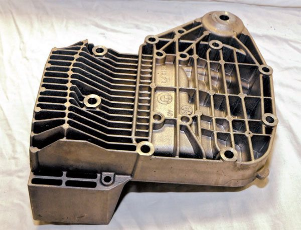 This BMW differential housing cover is a complex shape to coat. The ribs and valleys help this part stay cool and also provide structural rigidity. It is made from cast aluminum alloy.