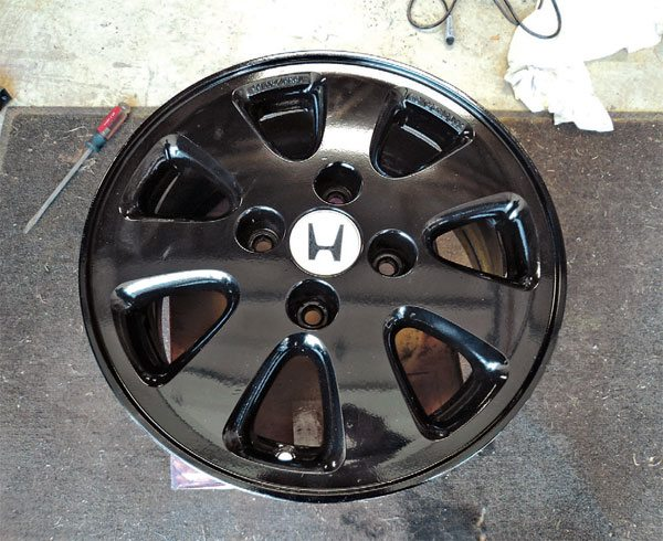 This wheel now looks fantastic, and the powder coat will hold up much better against the elements. Some people have theorized that the curing process weakens an alloy wheel, but at a cure temperature of 350 degrees F, this process is far from the temperatures needed to affect aluminum structurally. Many automakers now deliver alloy wheels already powder coated.