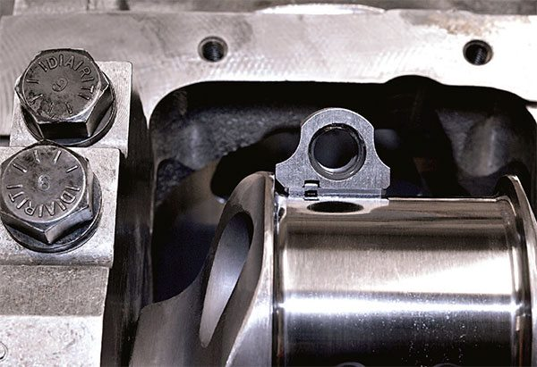 Close-up shows the fillet radius on the crankshaft journal and the bearing chamfer that prevents the bearing from riding against the radius.
